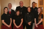 Before dinner, Mr. and Mrs. Ferrell get together with Archbishop Naumann, Clarissa Fierro '13, Karla Sepúlveda '14, Xavier Tucker '14 and Theresa Collins '13.
