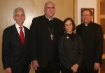 Mr. Ferrell, Archbishop Naumann, Mrs. Ferrell and Father Hermes.